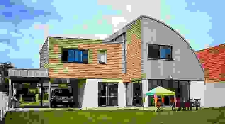 maison ossature bois Lieux d'événements modernes par homify Moderne Bois Effet bois