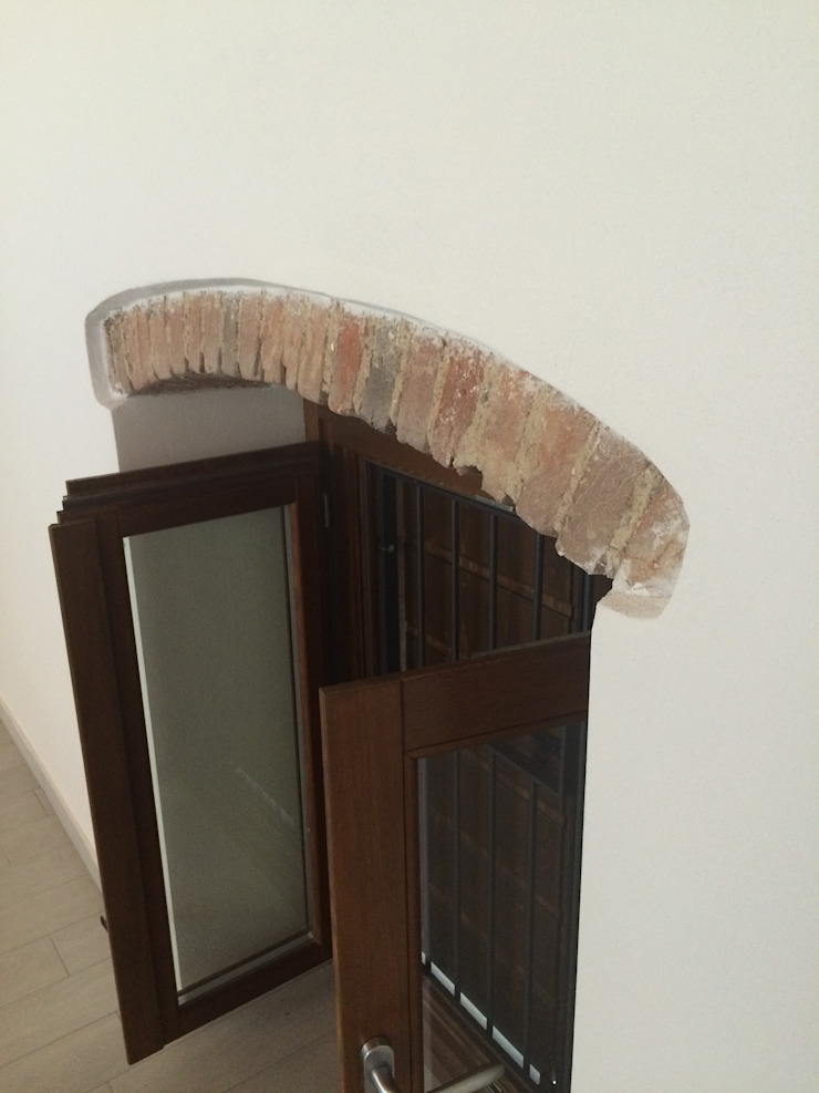 Realizzazioni Adami|Zeni Ingegneria e Architettura Puertas y ventanas de estilo moderno