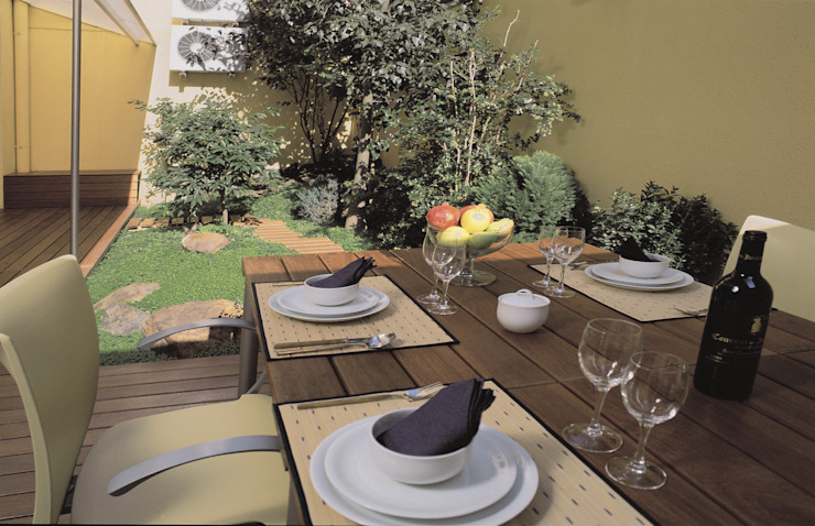 Exterior dinning area and garden created in a patio in uptown Barcelona by Daifuku Designs Asian