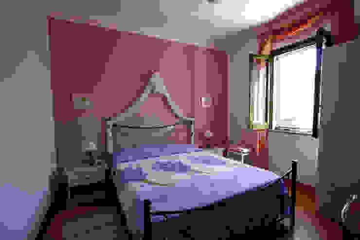 Camera degli ospiti DL interior design Camera da letto in stile mediterraneo