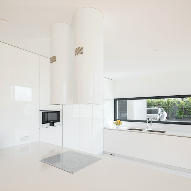 Casa Touguinhó II Cozinhas minimalistas por Raulino Silva Arquitecto Unip. Lda Minimalista Quartzo