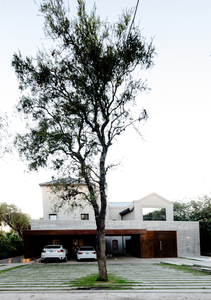 Modern home by BLOS Arquitectos Modern Concrete