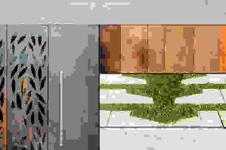 Paredes e pisos modernos por BLOS Arquitectos Moderno