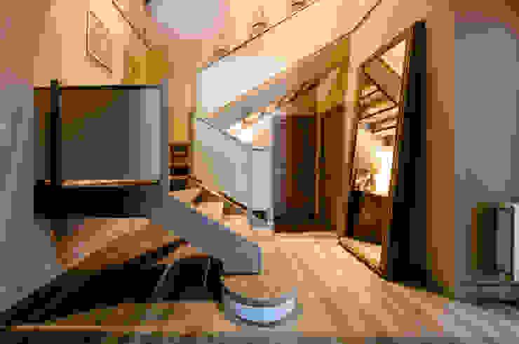 BLOS Arquitectos Modern Corridor, Hallway and Staircase Beige