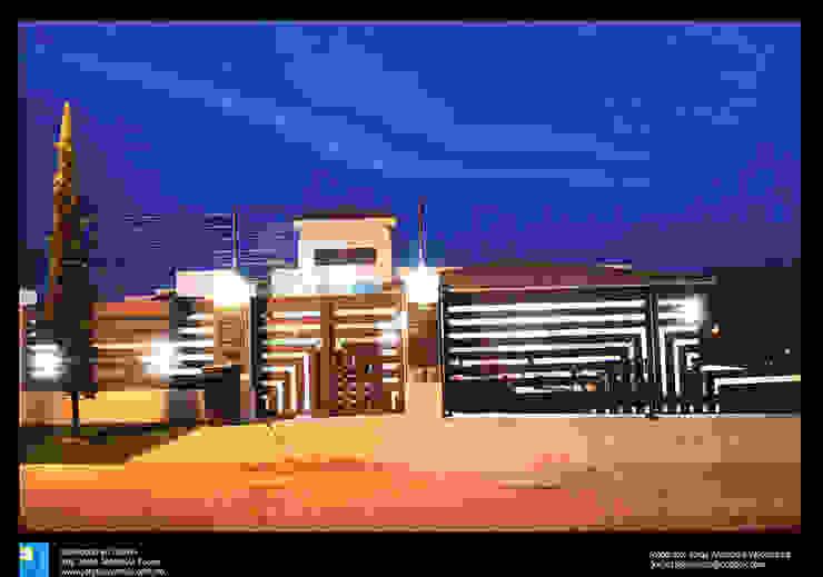 fachada nocturna Casas modernas de Excelencia en Diseño Moderno Ladrillos