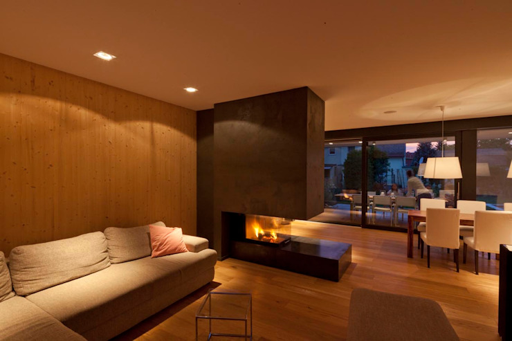 Salones modernos de PASCHINGER ARCHITEKTEN ZT KG Moderno Concreto