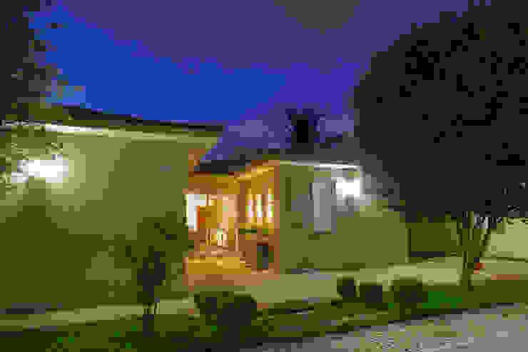 Fachada - Casa no Bandeirantes Casas ecléticas por A3 Arquitetura e Interiores Eclético