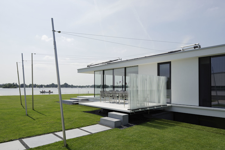 Modern houses by Lab32 architecten Modern