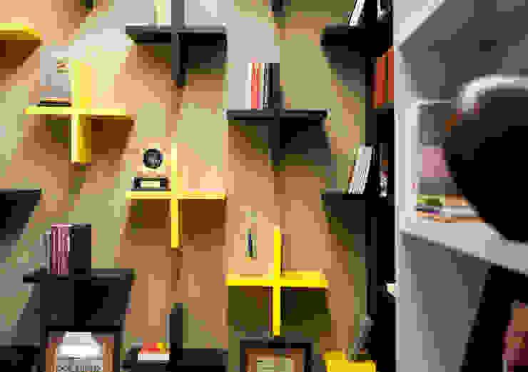 Detalhe prateleiras em cruz coloridas Espaços comerciais modernos por Tatiana Junkes Arquitetura e Luminotécnica Moderno