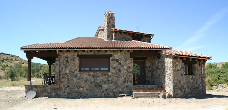 Rustic style house by Arq0 Rustic