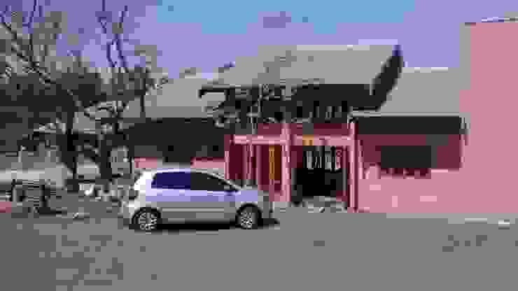 Arcoterra Arquitetura e Construção Tropical style houses Bricks Orange