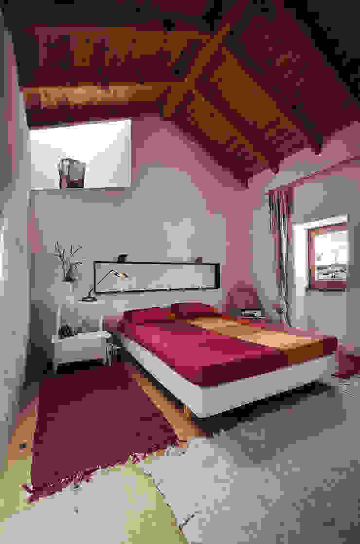 Rustic style bedroom by pedro quintela studio Rustic Stone
