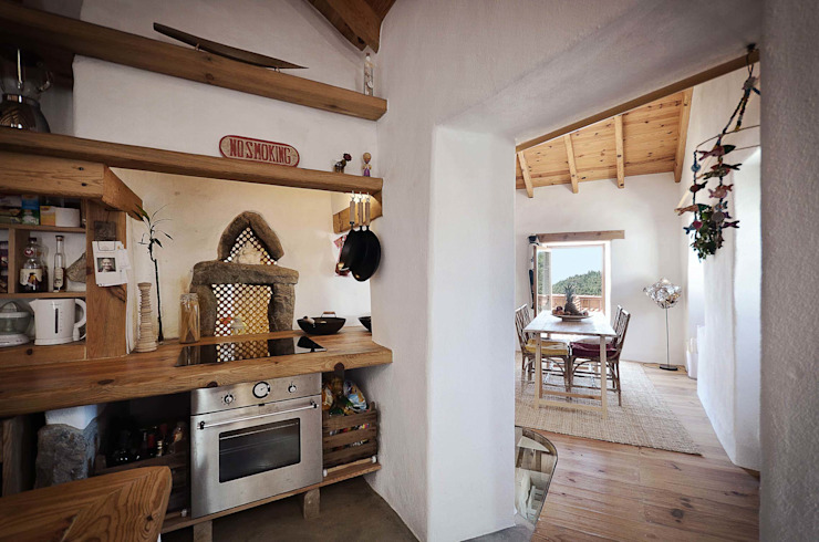 pedro quintela studio Rustic style dining room Stone Wood effect
