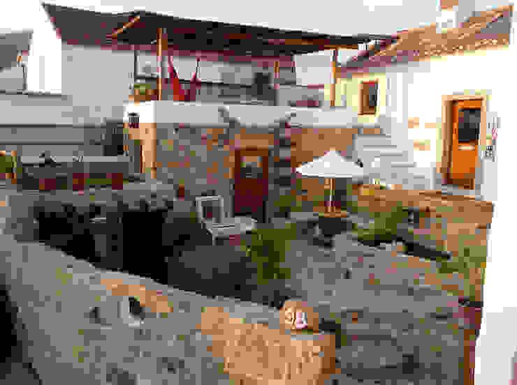 Casas de estilo  por pedro quintela studio, Rústico Piedra