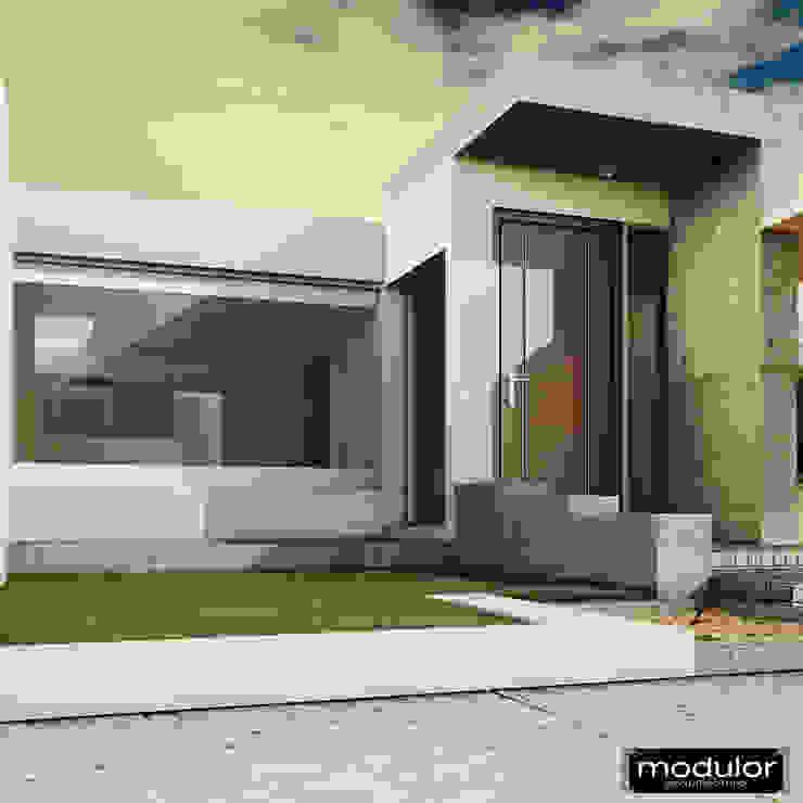 Acceso Interior Casas modernas de Modulor Arquitectura Moderno Piedra