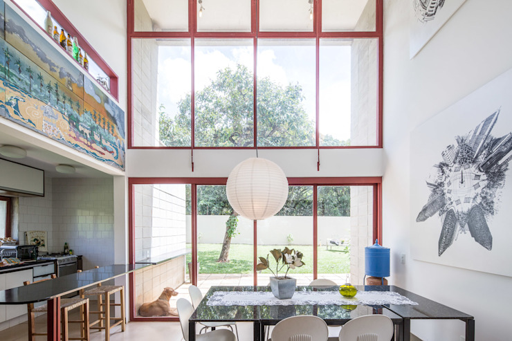 Industrial style dining room by Joana França Industrial