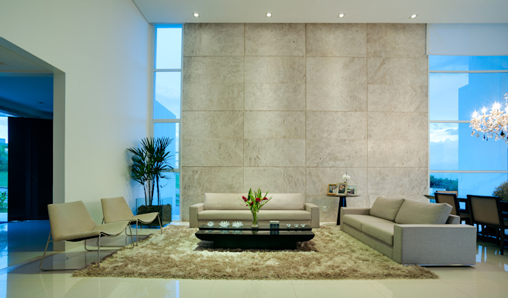Salas modernas de dayala+rafael arquitetura Moderno Piedra