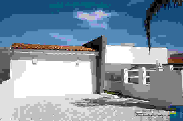 la fachada Casas modernas de Excelencia en Diseño Moderno Ladrillos