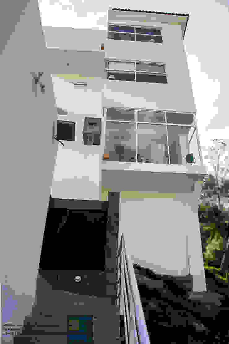 FACHADA TRASERA Casas modernas de Excelencia en Diseño Moderno Ladrillos