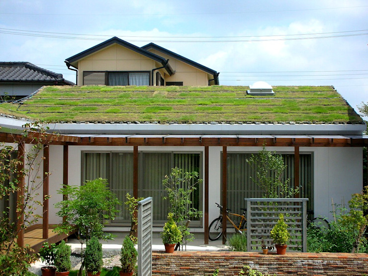 Rustic style house by 小栗建築設計室 Rustic