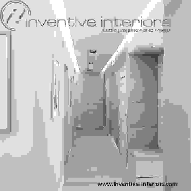 Inventive Interiors jasny przytulny przedpokój Nowoczesny korytarz, przedpokój i schody od Inventive Interiors Nowoczesny