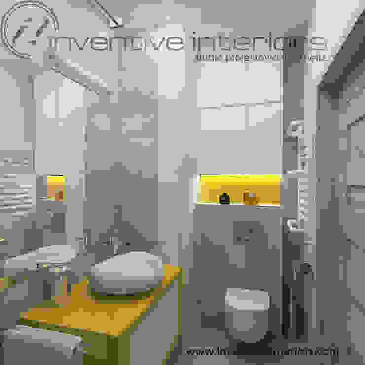 Inventive Interiors szaro-biała łazienka z żółtym akcentem Nowoczesna łazienka od Inventive Interiors Nowoczesny Beton