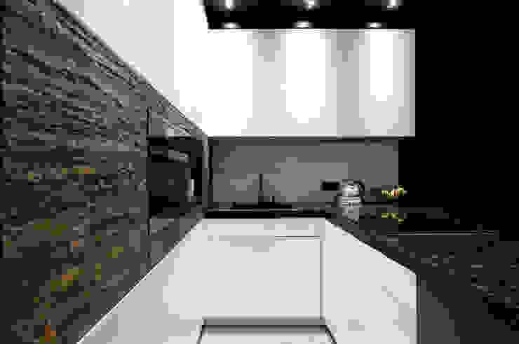 Elegancki apartament, w którym  króluje czerń: styl , w kategorii Kuchnia zaprojektowany przez FLOW Franiak&Caturowa,Nowoczesny