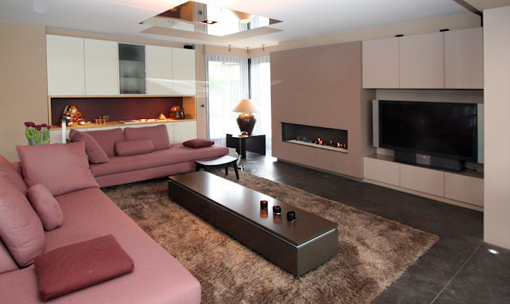 warm design interieur Moderne woonkamers van Sfeerontwerp Modern