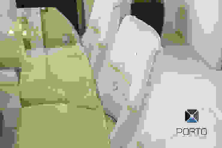 Sala da pranzo eclettica di PORTO Arquitectura + Diseño de Interiores Eclettico