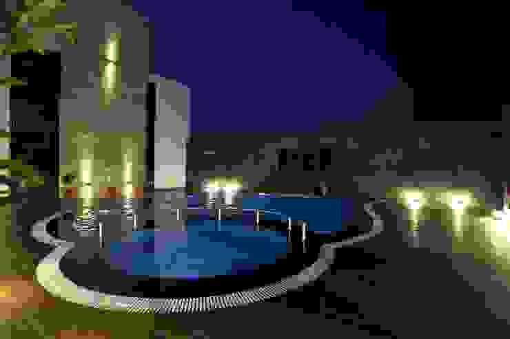 Hotel The Grand Daksh Modern pool by RUST the design studio Modern