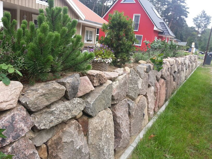 Country style garden by miacasa Country Granite