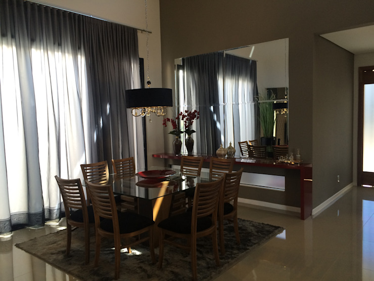 PROJETO DE INTERIORES – RESIDENCIAL LAGO SUL – BAURU / SP Salas de jantar modernas por Márcio Cortopassi Arquitetura Moderno