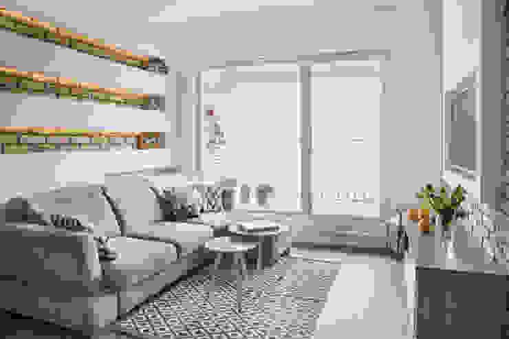 Modern living room by Bartosz Andrzejczak Architekt Wnętrz Modern