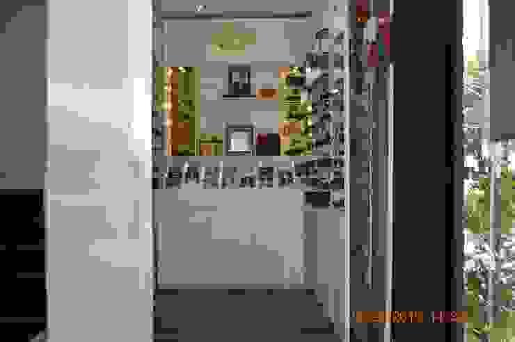 Ótica Fast Lojas & Imóveis comerciais modernos por Fabiana Rosello Arquitetura e Interiores Moderno