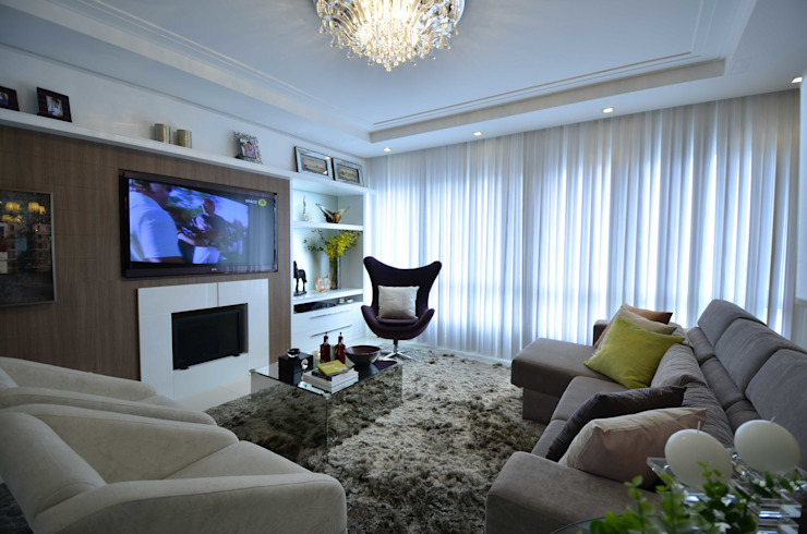 Versátil e luminoso Salas de estar modernas por Marcelo Minuscoli - Projetos Personalizados Moderno