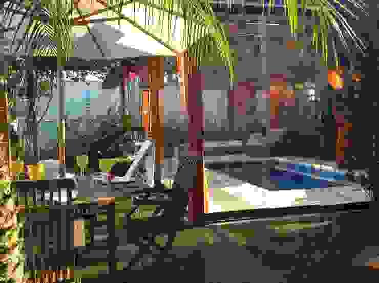 Projeto MF Interiores - Piscina e SPA para todas as estações Piscinas tropicais por MF Interiores Tropical