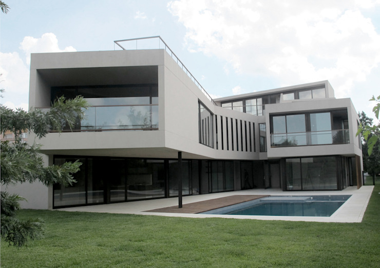 Modern houses by FILM OBRAS DE ARQUITECTURA Modern Concrete