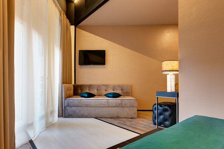 Camera tripla Hotel moderni di FAUSTO DI ROCCO ARCHITETTO Moderno Legno Effetto legno