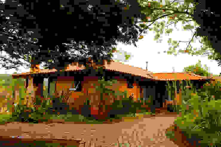 POUSADA MARIA MANHÃ Casas rústicas por MADUEÑO ARQUITETURA & ENGENHARIA Rústico