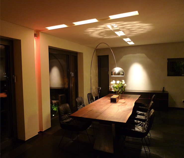 Modern dining room by Bolz Licht und Wohnen 1946 Modern