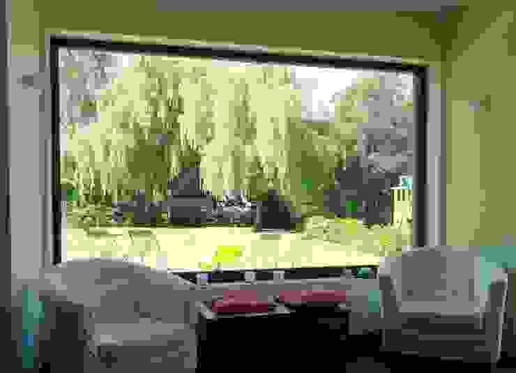 Maison basse énergie à Wavre Salon moderne par Bureau d'Architectes Desmedt Purnelle Moderne