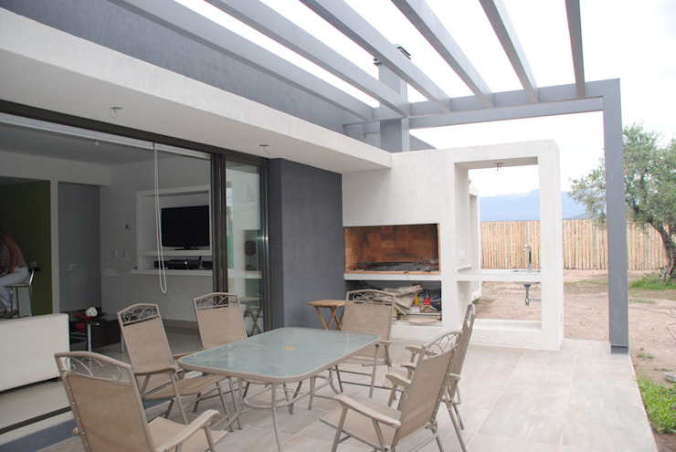 Casa Boedo: Jardines de estilo  por Bonomo&Crespo Arquitectura,Ecléctico