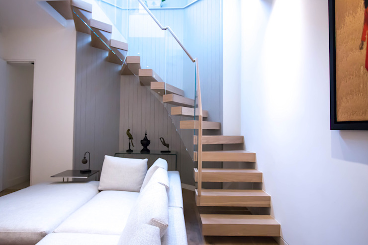 Cantilever staircase with glass balustrade Railing London Ltd Modern corridor, hallway & stairs