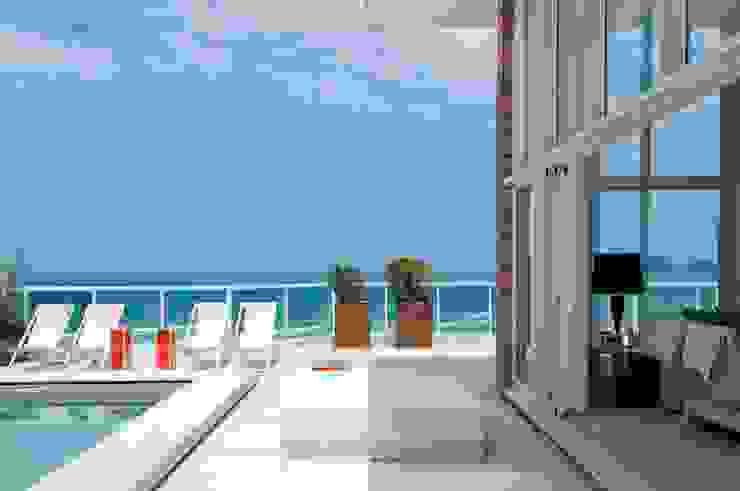 Cobertura Riviera Varandas, alpendres e terraços modernos por Toninho Noronha Arquitetura Moderno