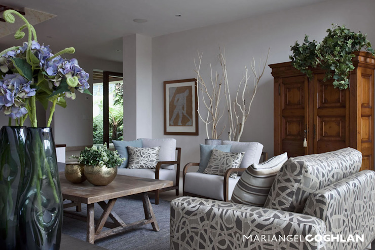Salas / recibidores de estilo  por MARIANGEL COGHLAN,
