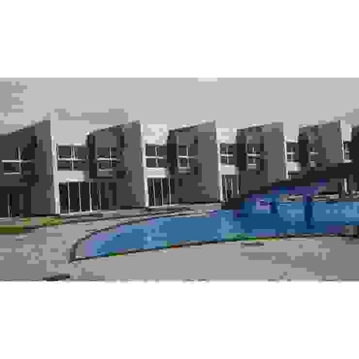 Vista Real de las casas del conjunto Costa Blanca Grupo JOV Arquitectos Casas de estilo minimalista Piedra Blanco