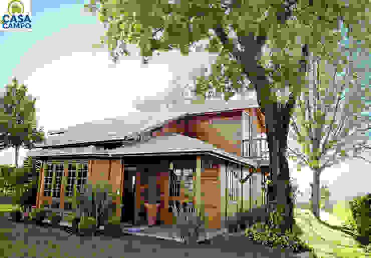 Casas em madeira por CASA & CAMPO - Casas pré-fabricadas em madeiras