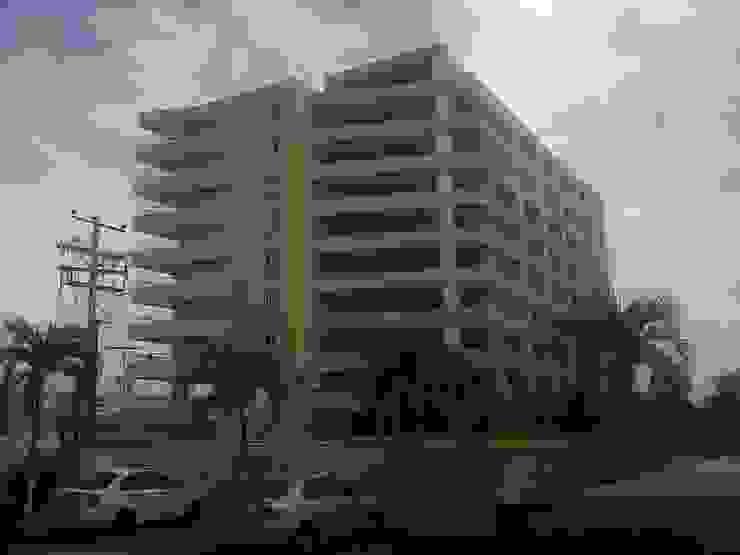 CONJUNTO RESIDENCIAL ABISAI SUITES Grupo JOV Arquitectos Casas modernas Piedra Marrón