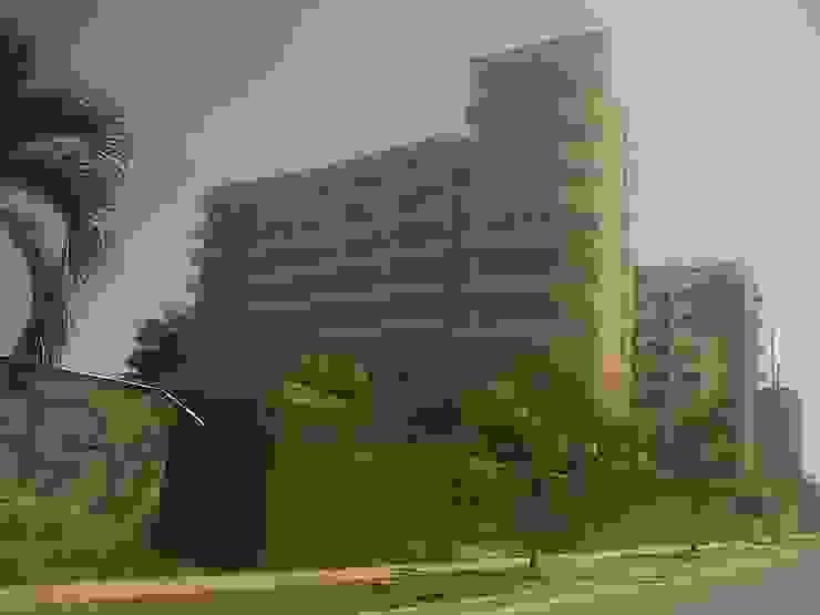 FACHADA PRINCIPAL RESIDENCIA ABISAI SUITES Grupo JOV Arquitectos Casas modernas Piedra Marrón
