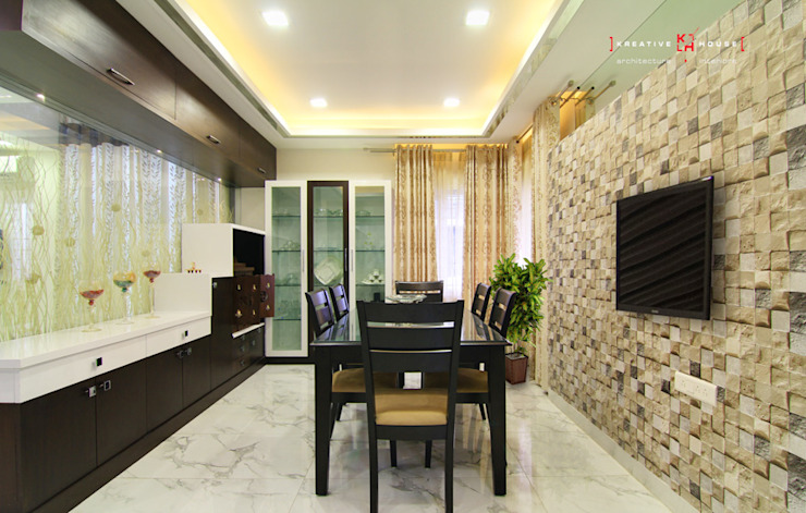 A TRIPLEX VILLA NEAR SUNCITY, HYDERABAD Modern dining room by KREATIVE HOUSE Modern